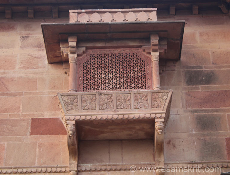 A window on first floor of palace. Note the design, intricate work, how it allows wind to pass through thus keeps the palace cool.