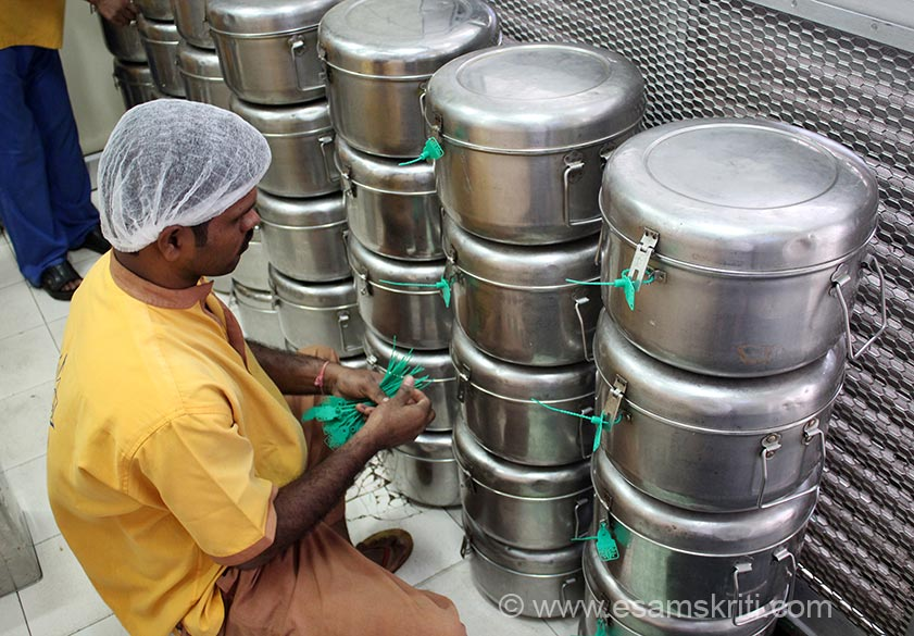 Once container is filled, closed it is sealed as you see a devotee doing in this picture. Schools have been instructed not to serve food if seal is tampered and report ASAP. In Maharashtra ISKCON operates kitchens in Tardeo Mumbai, Mira road near Mumbai, Palghar, Wada, Aurangabad MIDC, Nigdi (near Pune).