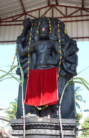 """The PANCHAMUGA [Five-Faced ] Hanuman Temple is 2 kms from main temple. The deity of the Hanuman is drawn with senthooram (Vermillion). Images of Sri Ram, Sita and Hanuman brought from Danushkodi during the 1964 cyclone are placed there. The Floating Stone used to build the Sethu Bandhanam or the bridge between India and Lanka too can be found in this temple."""