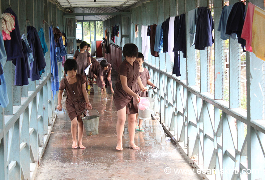 "Younger students cleaning the walk way in hostel. Loved to see this, taught dignity of labor from a young age. To see pics of Tawang War Memorial <a href =""http://www.esamskriti.com/photo-detail/Tawang-War-Memorial.aspx"" > Click here </a>"