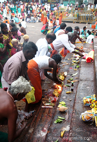 Devotees making offerings. Line for darshan was too long so we offered pranams from outside. Very powerful vibrations in temple. Felt very good there and after we left.