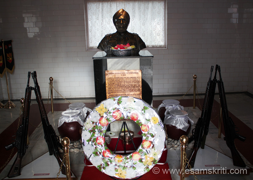 "Inside the memorial is a room dedicated to Subedar Joginder Singh. On 23/10/1962 the Chinese opened a heavy attack on the Bumla axis with the intent to break through in Tawang. Chinese came in 3 waves of about 200 each. Subedarji n team mowed down the first wave, second wave too but lost half of their men. They could not withstand the third attack and attained martyrdom. There is a memorial dedicated to Subedarji whose pics we shall upload separately. To hear Arun Shourie talk What will it take to face up to China <a href = ""http://www.esamskriti.com/essay-chapters/What-it-will-take-to-face-up-to-China-1.aspx"" target = ""_blank"" > Click here </a>"