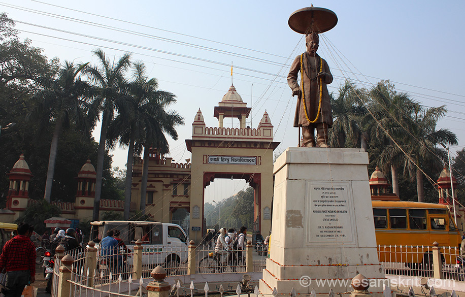 """Entrance to Banaras Hindu University. Image is of Pandit Madan Malaviyaji (1861-1946) who founded BHU. It is as important a place as the ghats of Kashi. Do visit, also see Bharat Kala Bhavan, the Art and Archaeological Museum and Birla Temple.  From here gets autos to go to Ramnagar. To know more about BHU site <a href=""""http://www.bhu.ac.in/"""" target=""""_blank""""> Click here </a>"""