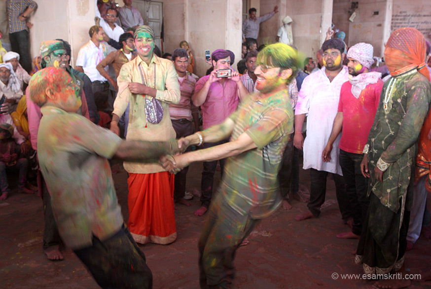 "Anand - happiness - joy. Great start to festival. ""The focus of the celebrations in Barsana is Lord Krishna. The 'Laddoo Holi' is celebrated a day-before the town celebrates ""Lathmar"" or Holi with staves during which women chase away men with sticks."""