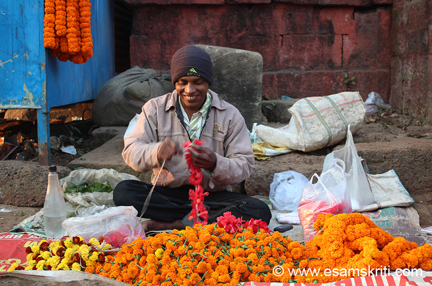 Flower vendor outside Lingaraj temple. Our temples generate so much of employment for people inside and outside the temple.