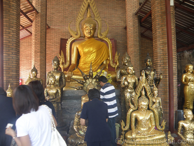 This picture is of a monastery in Ayutthaya Thailand (originally known as Ayothaya which refers to the capital of Shri Ram). Here you see the Thais affix a thin gold stip paper on the Buddha images.