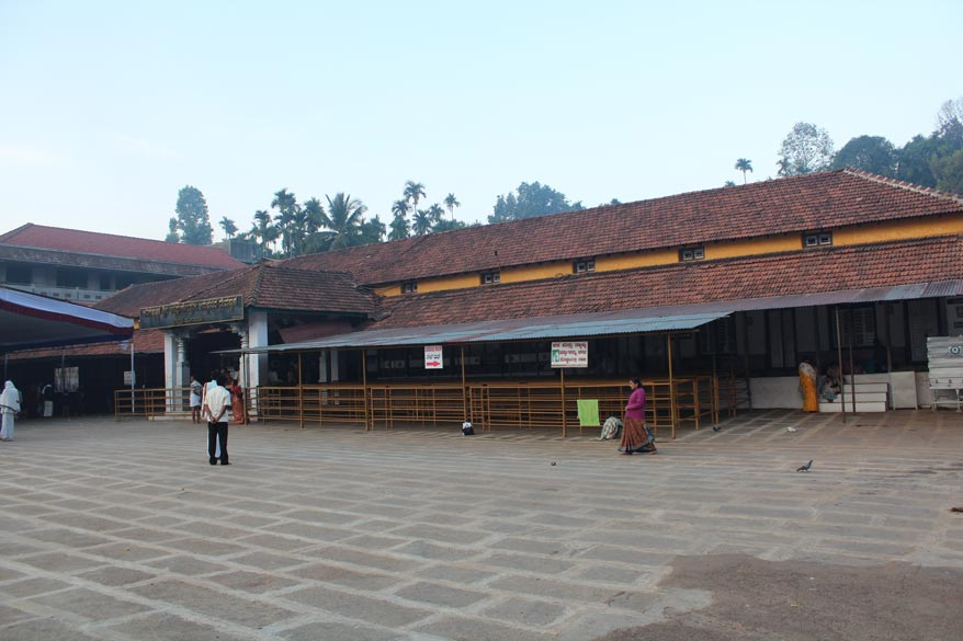 From the entrance u climb steps to reach this huge open area. In peak season parts of area are covered and people sleep there. In the centre is entrance to temple. Hornadu is 330 kms from 