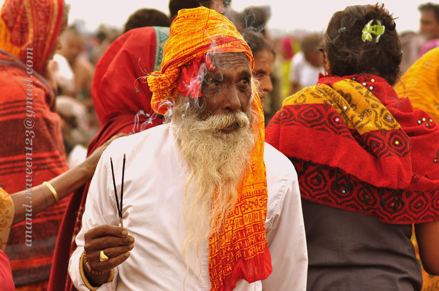 A man lights up his ``agarabattis`` - the entire atmosphere is awash with colours of real India. People who live in urban areas might not relate to the power of faith, look at it from a 