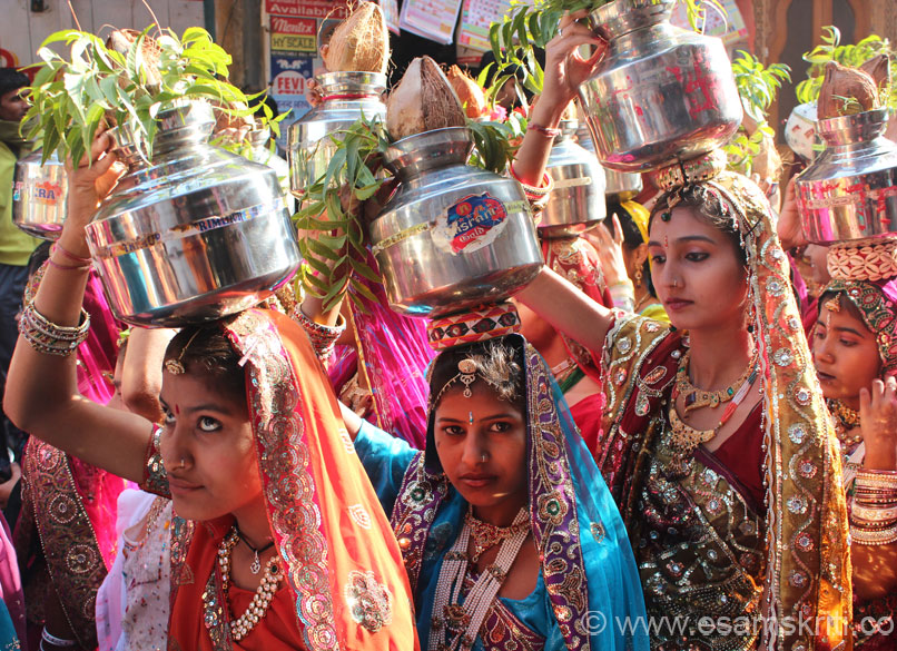 Another group of girls. On their head is a kalash embellished with Om and Swastik.