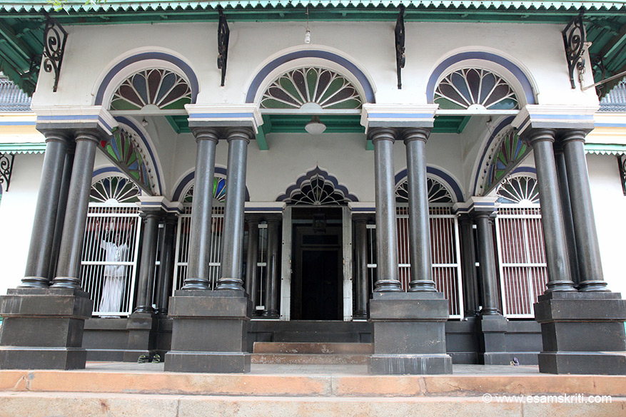 "A front view of the entrance. The glass work, tiles, columns so neatly designed. Usually only guests of the Bangala Hotel can visit MSMM House, got special permission to shoot pics. ""Pallathur, Devakottai and Kothamangalam villages, all within a 50 km-radius of the main town of Karaikudi, are also well known for their grand mansions"". Visit Periya Minor``s veedu in Devakottai, is supposed to be o/s with carved pillars, Italian floor tiles and a Spanish tiled roof"". It is 13 kms from Karaikaudi."