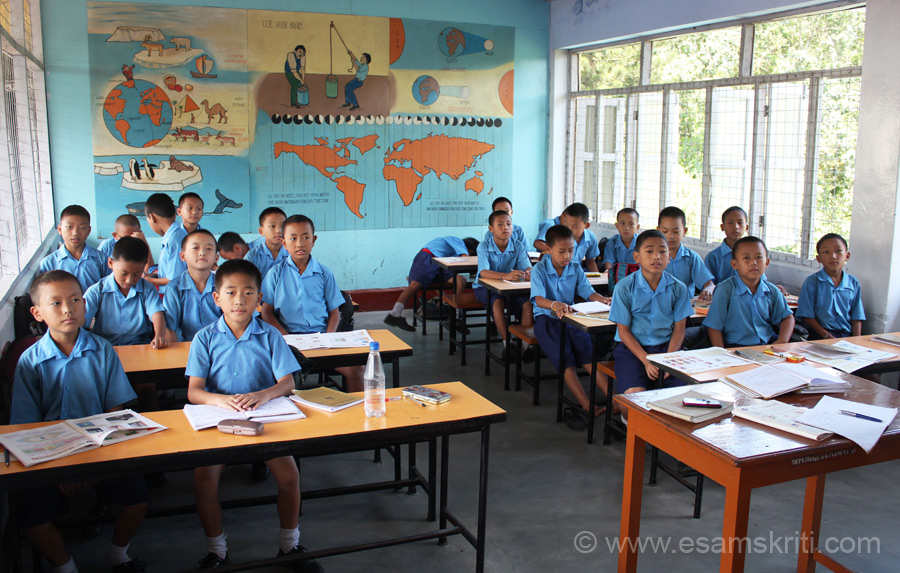 Another class in session. Note painting on wall behind. Students lucky to be in a school with so many trees - envy them.