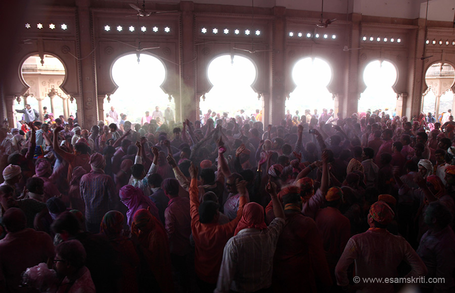 The entire hall is filled with devotees dancing.