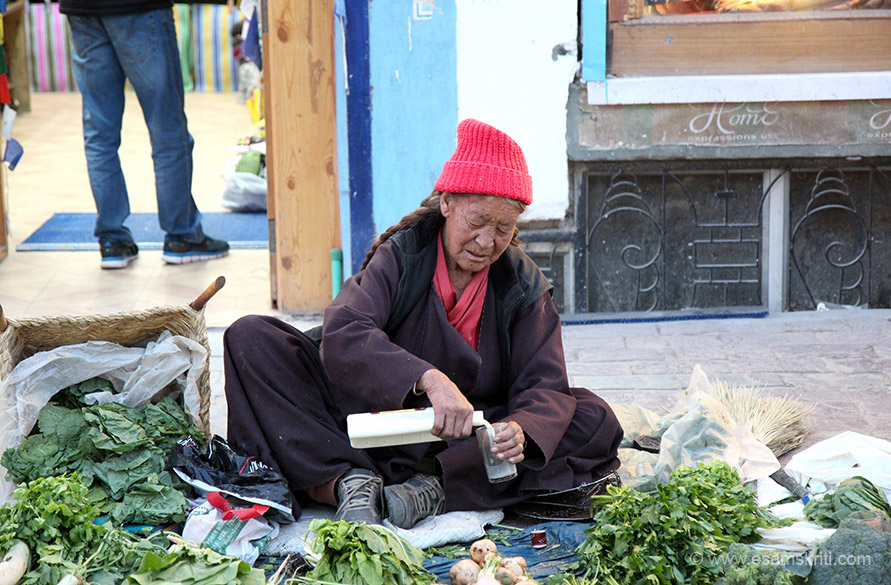 Old lady selling veggies in main market.