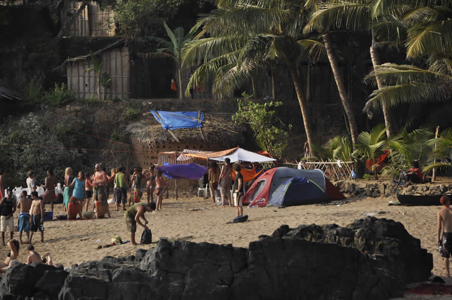 A close up of groups of foreigners chilling on the beach. One person got his guitar and played music on the entire beach. People just got together and decided to party. Some tourists live in tents on the beach as you can see, others live in huts.