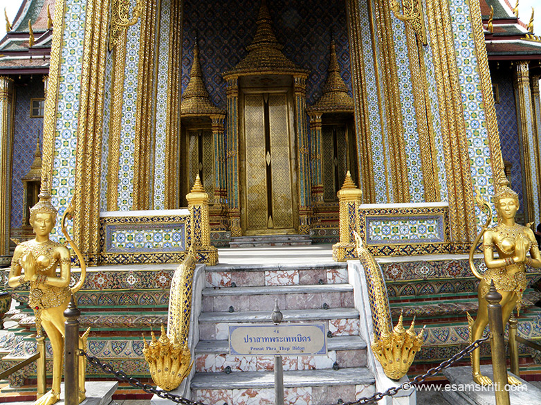 A close up of the entrance of Phra Dhepbidorn. They have a tail and animal type feet. They could be some sort of a demi-God or may be Kinnaries.