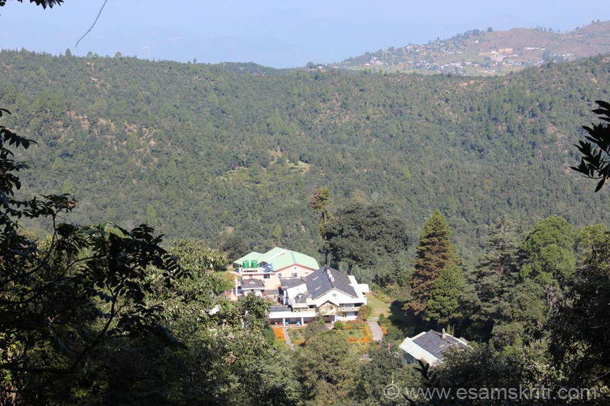 A view of the Ashram from a higher point during the trek to Dharamgarh. The hill behind the forests is Lohaghat. A few minutes away from the Ashram is the guest house to help spiritual