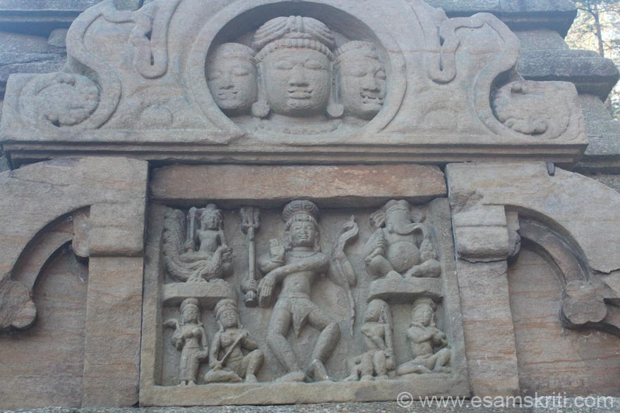 Top centre carving could be Buddhist not sure. Trishul in one hand and snake in another indicates Shiva image. Right is Ganapati, below that is person playing the flute. Left is 