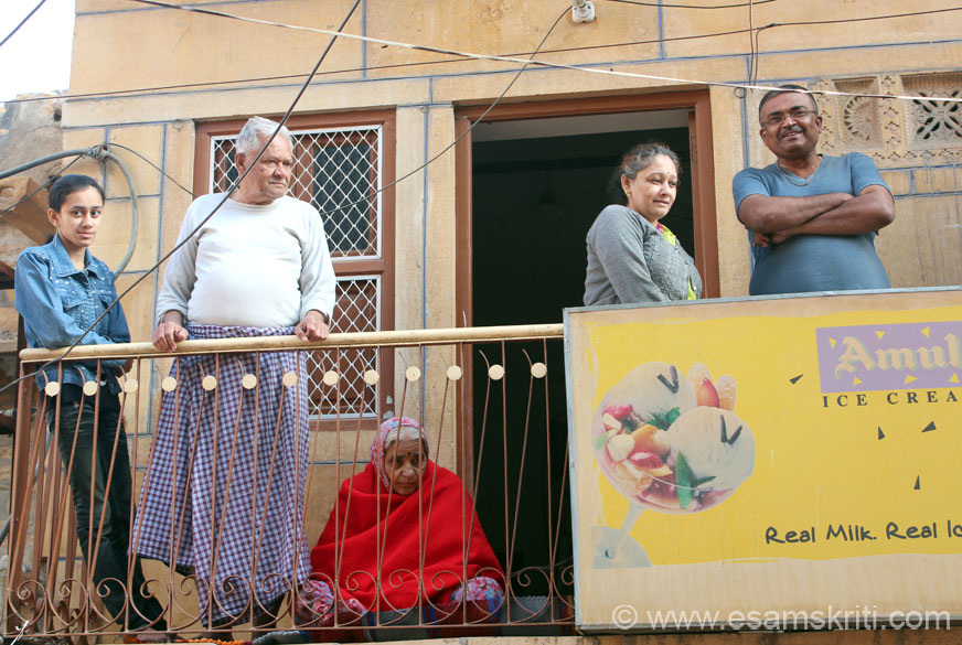 A number of local residents stood in their homes to watch the ceremonial procession. U see three generations of a family, grandfather, son and daughter. Note the expressions on their faces.