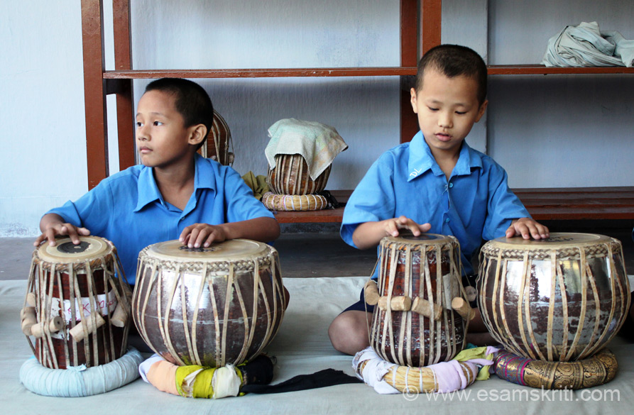 There is a separate tabla learning room. When we entered about ten students were learning the tabla.