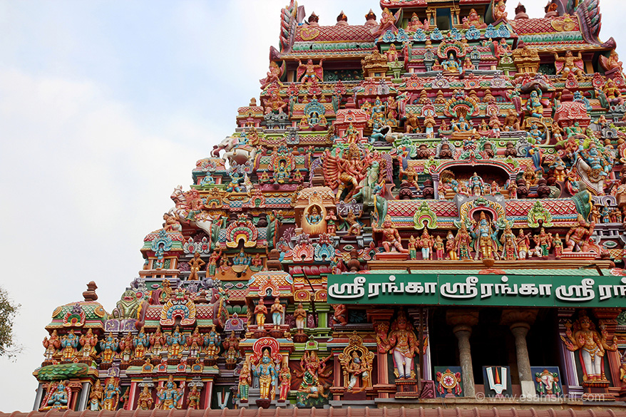 Close up gopuram shows various forms of Vishnu as Krishna, Narasimha, Varah. Right see Krishna holding Govardhan mountain. Centre right shows Lord Vishnu in reclining posture.