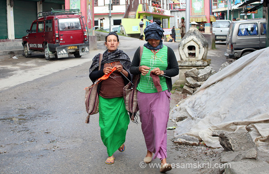 "Two ladies knitting and walking down the market road in Tawang. Have seen women watching TV, chatting and knitting but never walking. To see pics of women knitting, Woolens of Munisyari in Kumaon, Uttaranchal <a href=""http://www.esamskriti.com/photo-detail/Woollens-Munsyari.aspx"" target=""_blank""> Click here </a>"