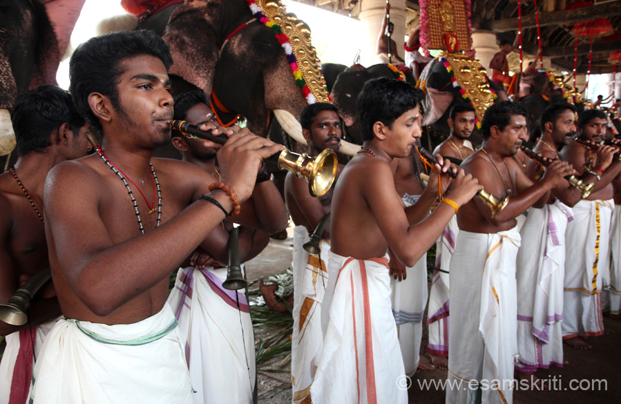 A close up of musicians playing the Kuzhal (like shehnai). ``A distinctive feature of Koodalmanikyam temple is that there is only one single Prathista. Even Vigneswara, usually found in all temples does not find place here``.