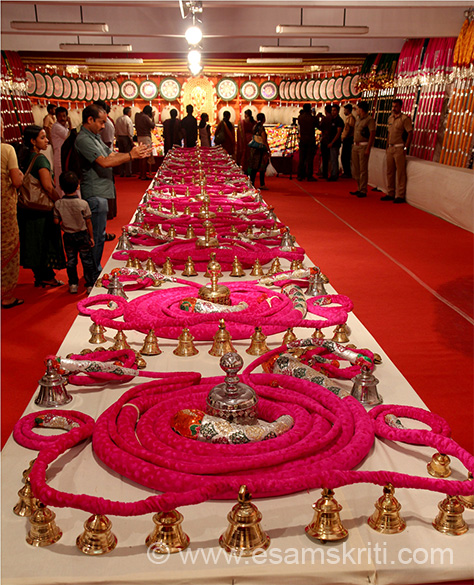 Now entered the hall of Paramekkavu temple. Overview of display on ground. Pink color rope (Vadam) that u see with bells is tied around the elephant``s neck.