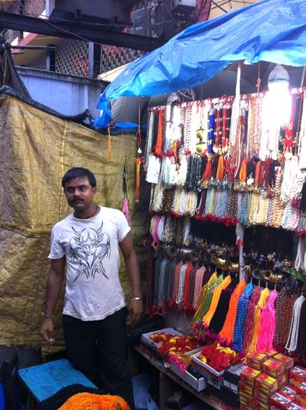 Another shop that sells thread which devotees tie on their wrists. Due to piligramages, yatras people travel around and see the country. They spend money and contribute to local economy of the