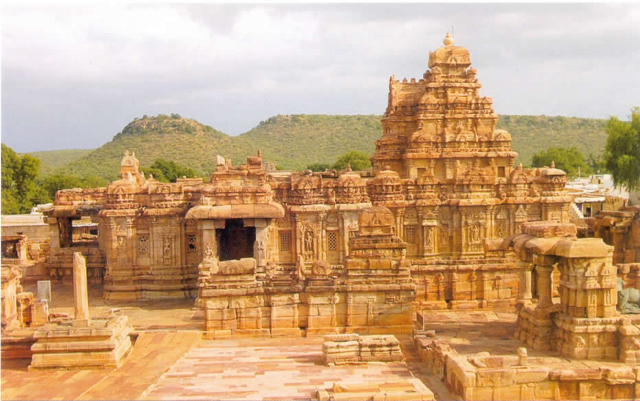 It is also called Lokeshwar temple that was built by Lokadevi, the Queen of Vikramaditya II in 740 A.D. in commemoration of the victory over the Pallavas. It measures 224 feet east-west and 105 feet north-south with one central shrine and two subsidiary shrines and a Nandimantapa that you cannot see in this picture. This picture is actually a post card. Extreme left you see the Vijay Sthamb that you saw in an earlier picture.