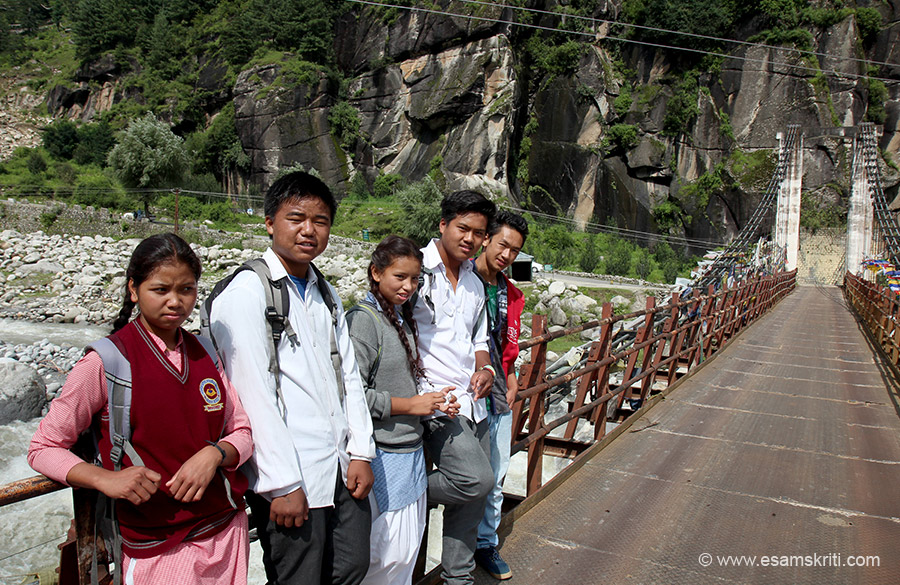 I hitched a bike ride from local who drove me through villages. Crossed the river on foot where met these Nepali kids returning from school.