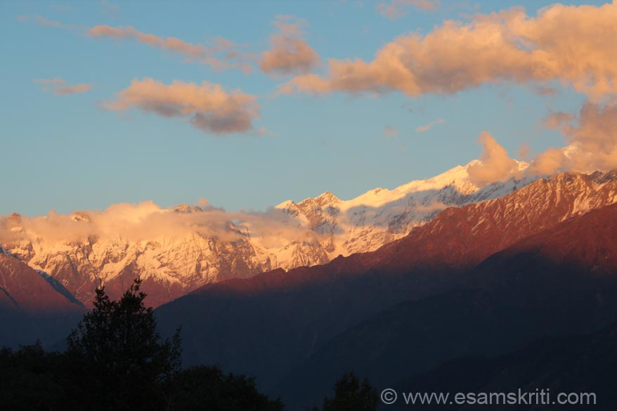 Sunset view of same snow clad peaks that you saw in earlier picture. Solar energy panels are widely used throughout the ashram.