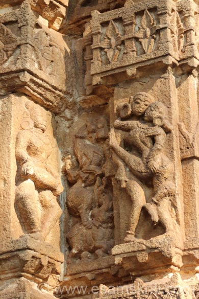 Left lady playing musical instrument. Right is erotic scene. In between image is of a horse type animal on an elephant. The Nagwanshi  Kings were believed to be  the practitioners of Tantra as their contemporaries in Khajuraho.