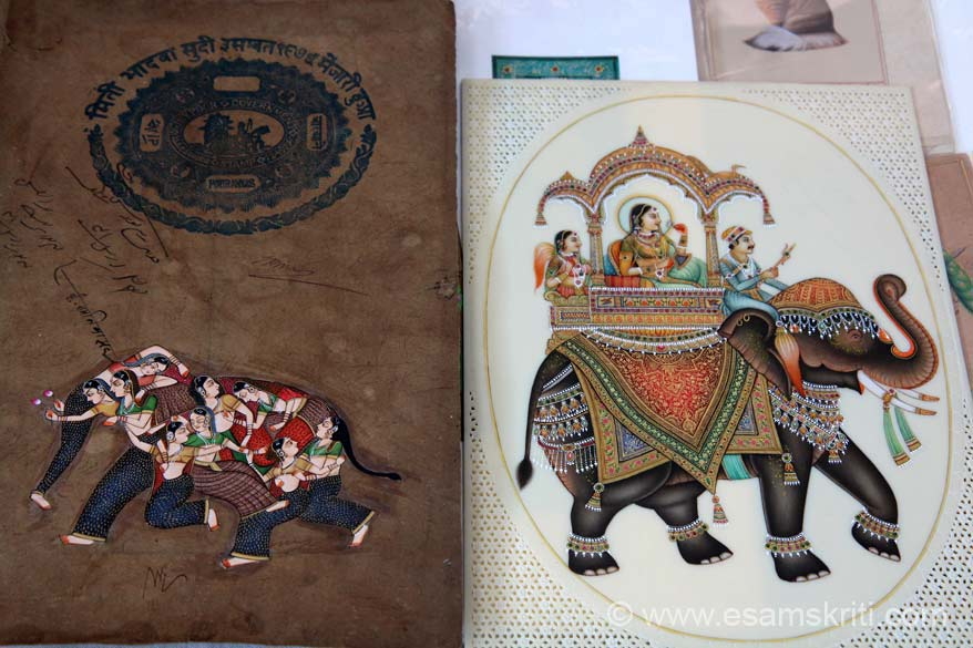 Miniature Arts by Mohan Kumar Prajapati - State awarded artist from Jaipur. On left is painting on old stamp paper. On right elephant ka pic - earlier this was made on ivory since government has banned use of ivory, it is now made in plastic.