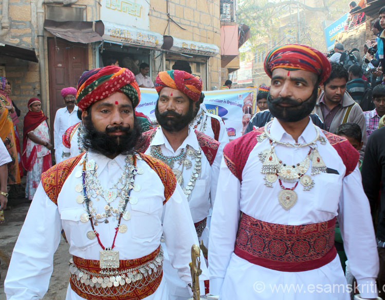 Another group of men in local clothes. Loved their ornaments, beard and moustaches. Sporting a Dharmic haar wearing all round the neck. Colorful cloth on waist is a kamar bandh.