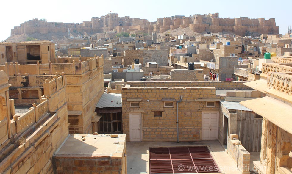 An overview of Jaisalmer Fort from the top most floor of Patwa Haveli. U see a flag flying i.e. the Raj Mahal or Royal Palace. To see pics of Jaisalmer Fort <a target=_blak href=http://www.esamskriti.com/photo-detail/Jaisalmer-Fort.aspx>Click here</a>