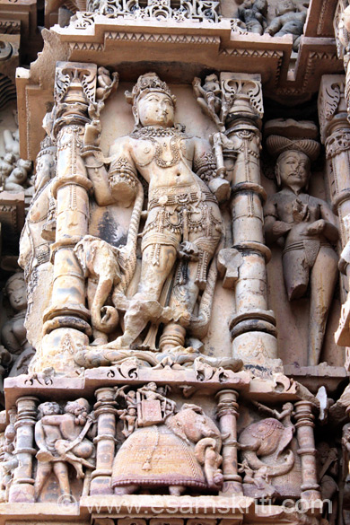 Lower level left to right is man and women in some sort of embrace but with weapon in hand, king seated on elephant in war with enemy also seated on elephant. Big image looks like that