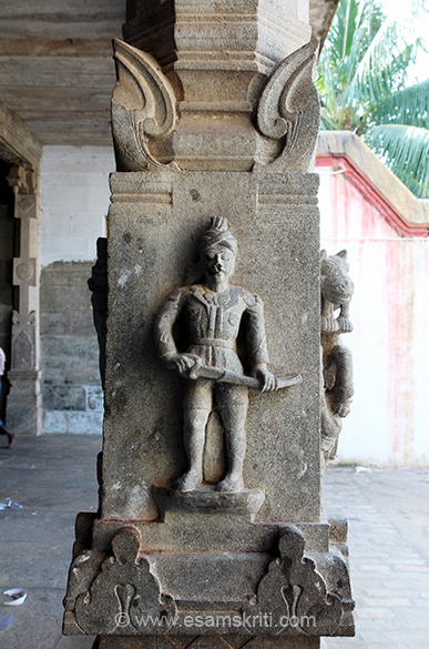 Sculpture shows warrior with sword.