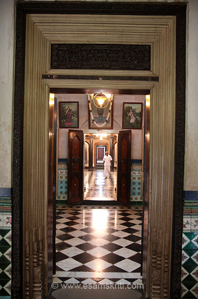 "Entrance to room 2. Design allows you see right to the other end of the bldg at one go. How did they get balance so right? ""Mansions have granite and marble pillars, polished and carved Burma teak, superb decorative tiles, Thanjavur