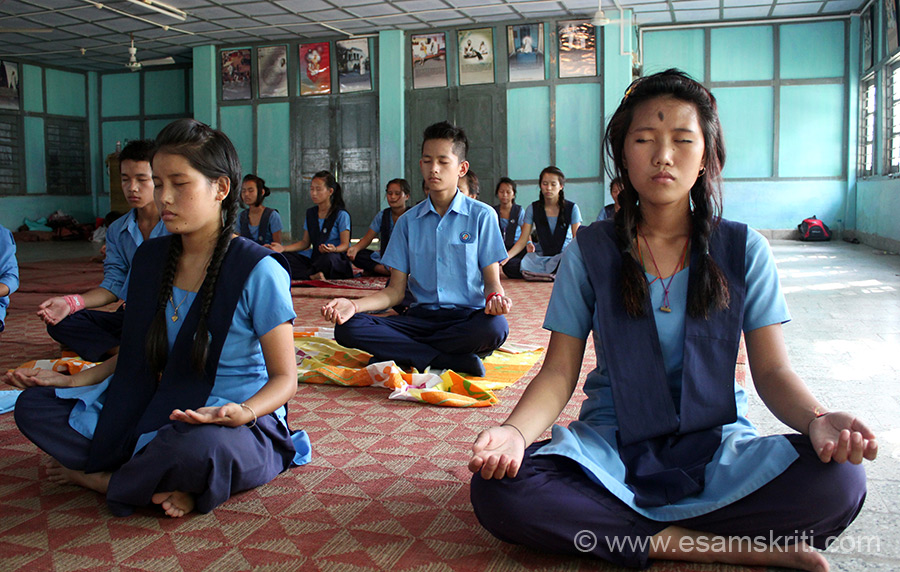 Students practicing meditation at a Art of Living class. School teachers visit home of parents whose children study in school. VKV is affiliated to C.B.S.E.