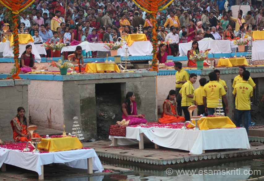A close up view of 3 levels of platforms where the Pandits stood and did Puja. U see devotees at far end of pic.