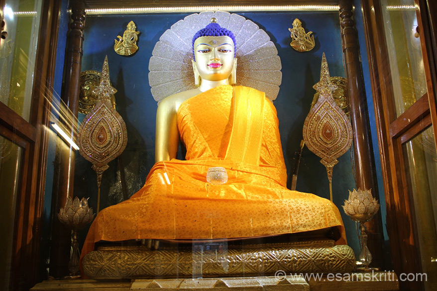 "Buddha looks different in different regions/countries. This image of Buddha is at Bodh Gaya Temple. To see pics of the temple <a href=""http://www.esamskriti.com/photo-detail/Bodh-Gaya-Temple.aspx"" target=""_blank""> Click here </a>"
