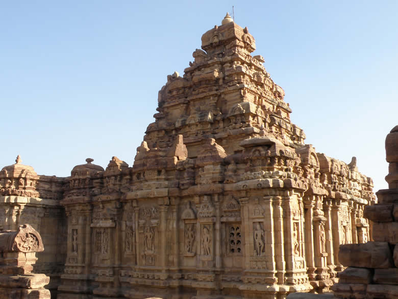 A side view of the temple. Note the sculptures on the walls of the temple. Remember the temple was made in stone.