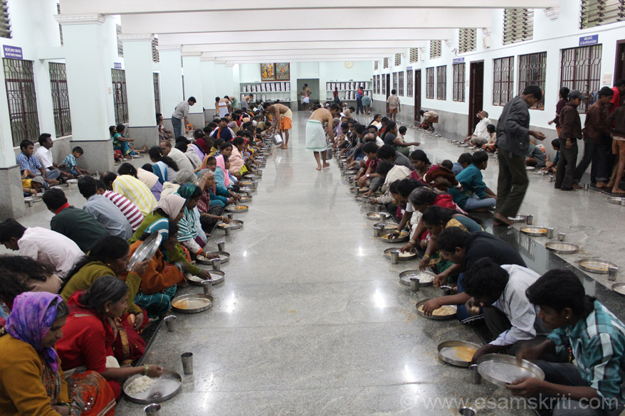 Dining hall. On right hand side of pic are wash basins where devotees wash hands after meals. Everyone eats and washes very calmly, no hussling.