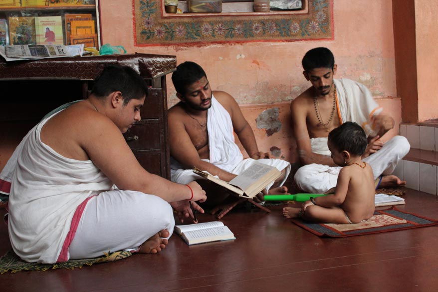 As I walked further into the house saw a pleasant sight of these young priests chanting verses from the Rig Veda in the presence of a young child. The Pandits that I spoke to though briefly gave 