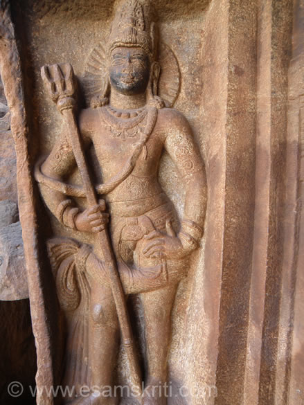 U see doorkeeper of cave temple. Note has a Trishul in his hand.