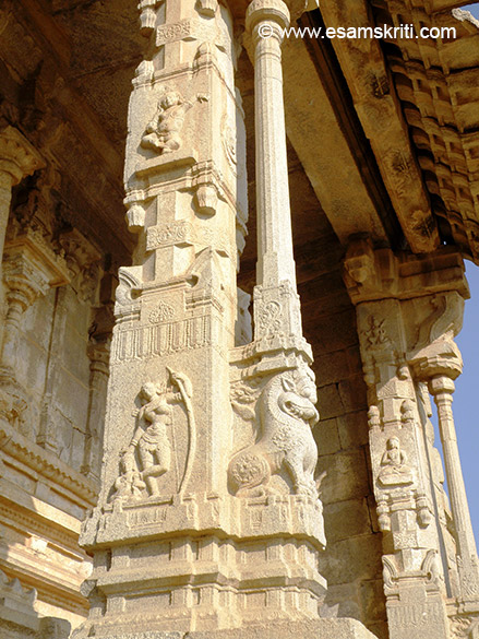 A close up of the pillar. U see a lady with a bow and slender pillar.