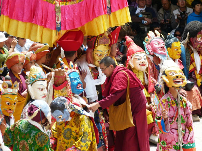 Each colorful mask depicts a different figure in the legend that``s being portrayed. The Padmasambhava dance, which shows the conquest of the ruta demons, includes Yama -- the God of death, and the black-hatted sorcerer, Guru Trakpo -- the vanquisher of all demons.