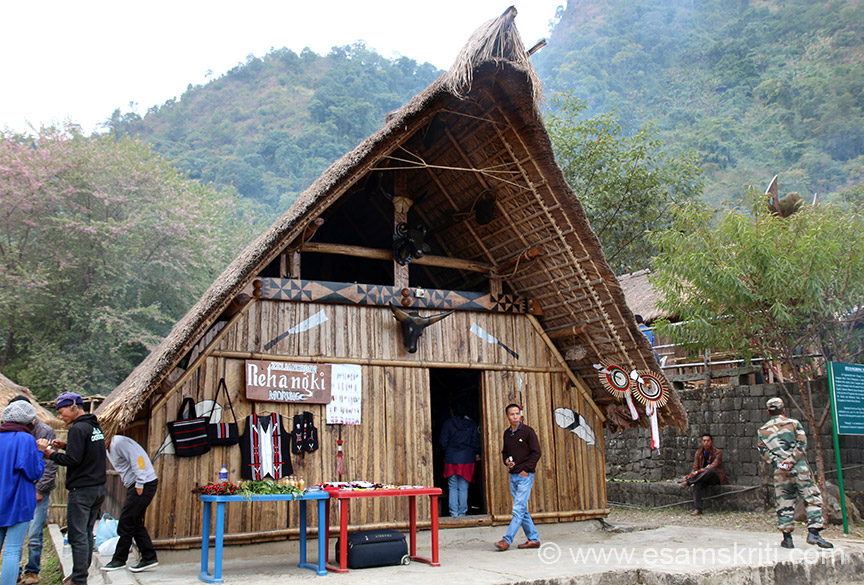 Typical home. Note the design of each home carefully, here they have displayed clothes as well. Centre u see face with horns of Mithun which symbolises wealth in Naga tradition.