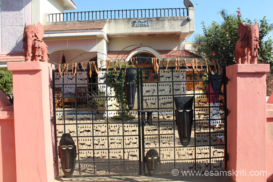 Gate of Tiju Ram home gate which showcases local craft. Elephants are of terracotta while gate is of wrought iron. At various points saw adivasis working both individually, in small 