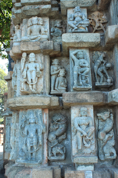 Images of various Gods and Goddesses. Top extreme left is three faced God perhaps Brahma.